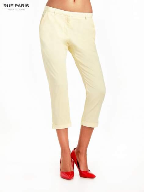 Jasnożółte eleganckie spodnie za kolano                                  zdj.                                  1