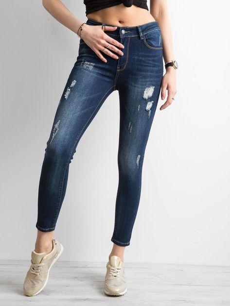 Jeansowe spodnie skinny z przetarciami niebieskie                              zdj.                              1