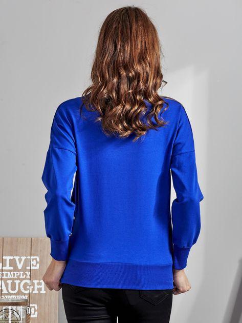 Kobaltowa bluza z rozcięciami i perełkami                              zdj.                              1