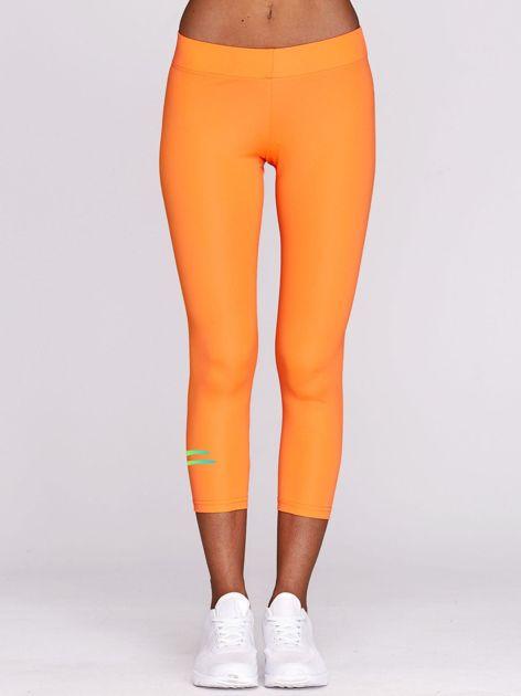 Legginsy do biegania z nadrukiem logo fluopomarańczowe                                  zdj.                                  2