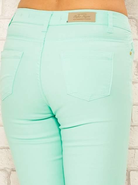 Miętowe spodnie rurki skinny z kieszeniami                                  zdj.                                  7