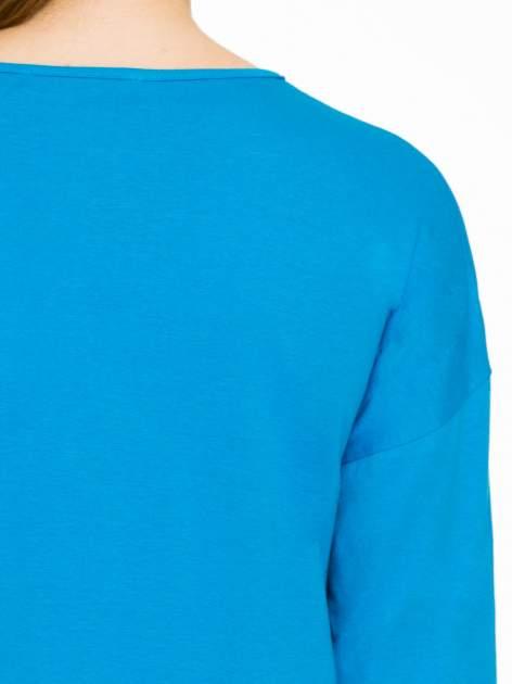 Niebieska gładka bluzka z luźnymi rękawami 3/4                                  zdj.                                  7
