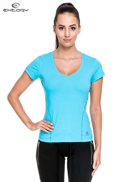Niebieski damski t-shirt sportowy z modelującymi przeszyciami                                  zdj.                                  1