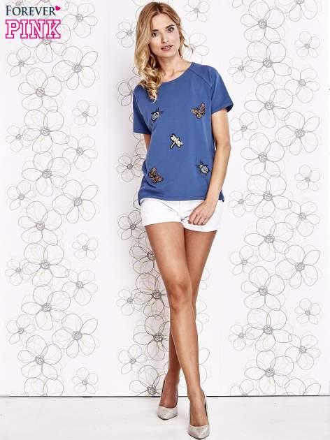 Niebieski t-shirt z aplikacją owadów                                   zdj.                                  2