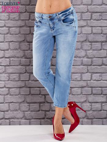 Niebieskie dekatyzowane spodnie jeansowe                                  zdj.                                  1