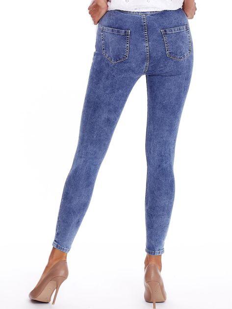 Niebieskie denimowe spodnie high waist                              zdj.                              2