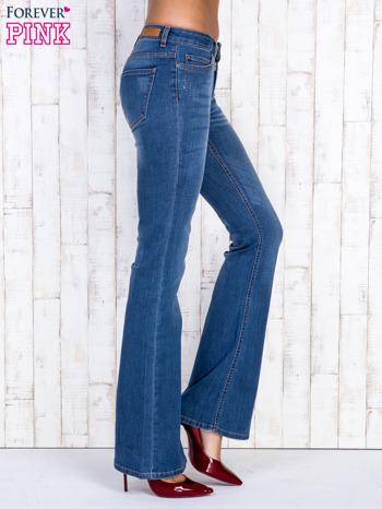 Niebieskie jeansowe spodnie dzwony z przetarciami                                  zdj.                                  3