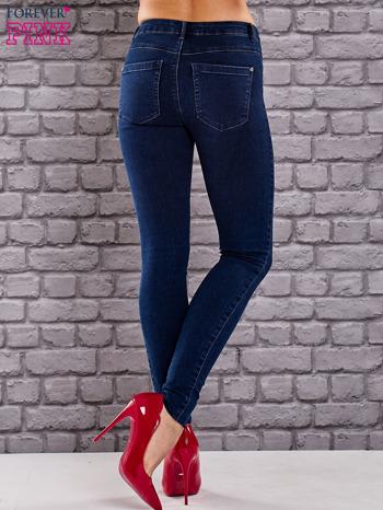 Niebieskie jeansowe spodnie skinny jeans z kieszeniami                                  zdj.                                  3