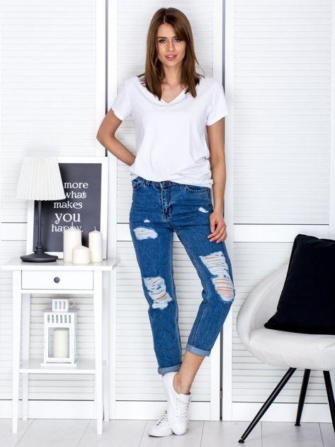 Niebieskie jeansowe spodnie z przetarciami                              zdj.                              4