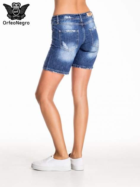 Niebieskie jeansowe szorty z przecieraną nogawką                                  zdj.                                  4