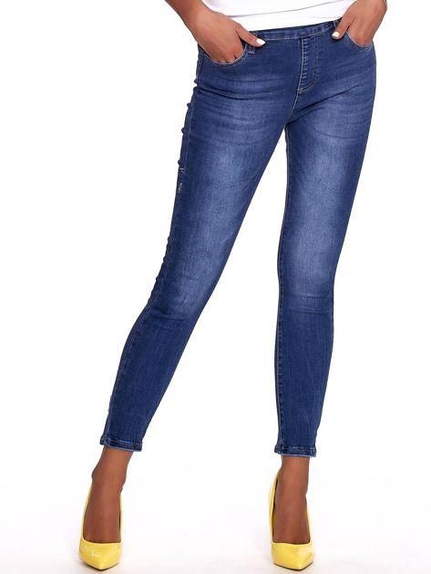 Niebieskie jeansy damskie slim fit z suwakiem z tyłu                              zdj.                              1