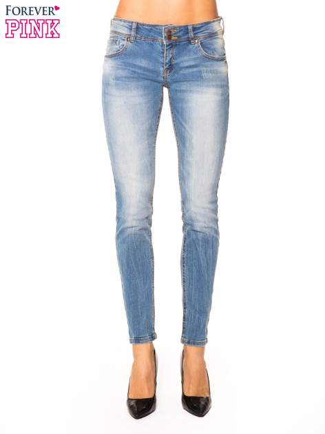 Niebieskie jeansy rurki wycierane                                  zdj.                                  1