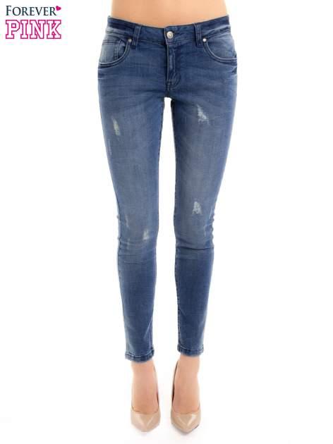 Niebieskie jeansy rurki z przetarciami                                  zdj.                                  1