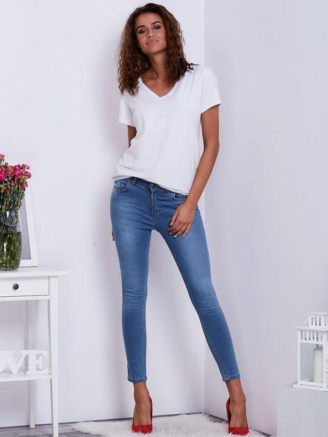 Niebieskie jeansy rurki z wysokim stanem                               zdj.                              4