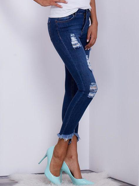 Niebieskie jeansy skinny z wystrzępieniami i przedarciami                              zdj.                              5