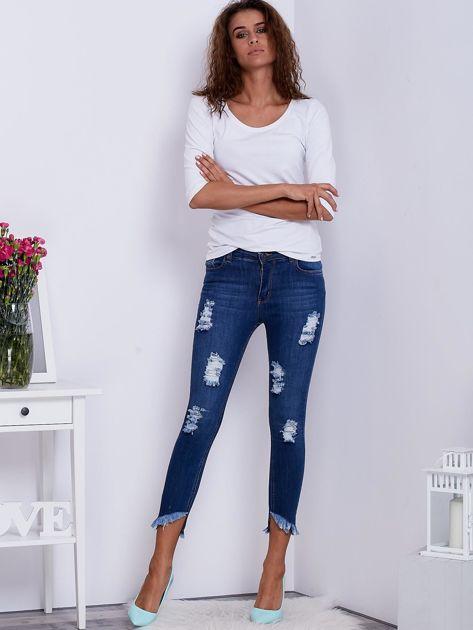 Niebieskie jeansy skinny z wystrzępieniami i przedarciami                              zdj.                              4