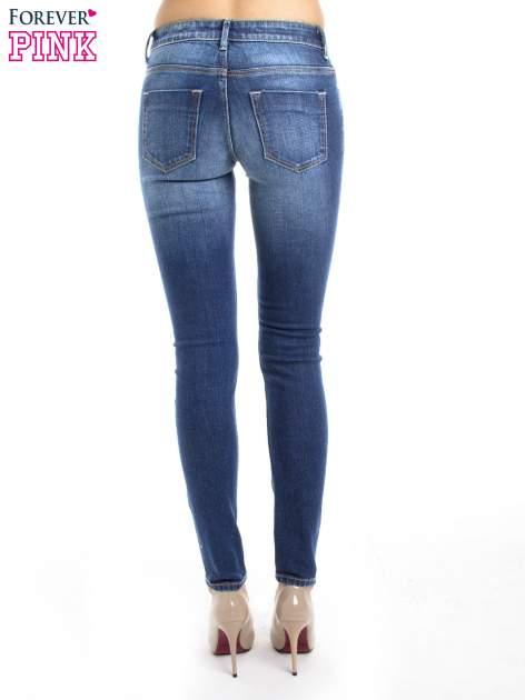 Niebieskie jeansy slim fit                                  zdj.                                  4