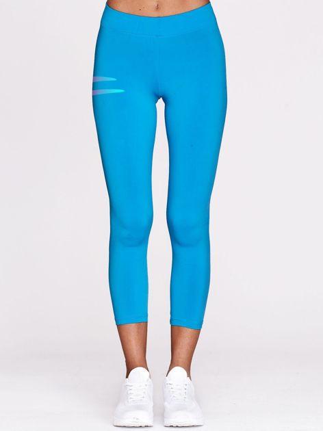 Niebieskie legginsy fitness z graficznym znakiem                                  zdj.                                  2