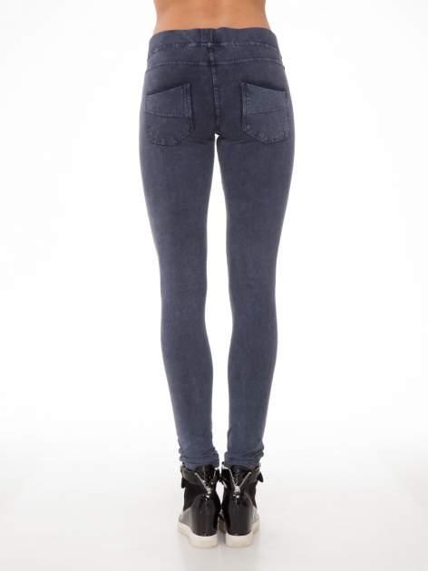 Niebieskie legginsy typu jegginsy                                  zdj.                                  4