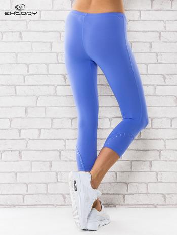 Niebieskie legginsy z dżetami na nogawkach                                  zdj.                                  2