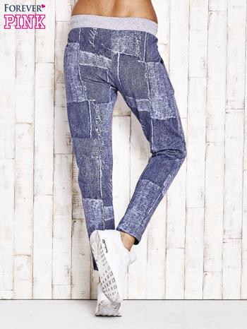 Niebieskie ocieplane spodnie dresowe                                   zdj.                                  3