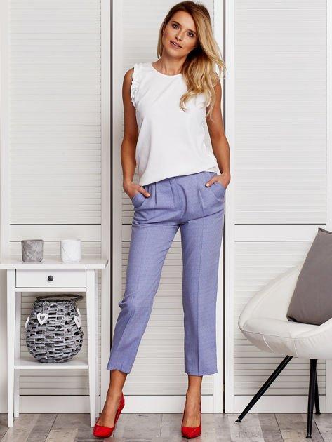 Niebieskie spodnie 7/8 w drobny deseń                              zdj.                              4