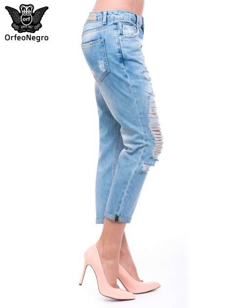 Niebieskie spodnie girlfriend jeans 7/8 z przetarciami                                  zdj.                                  3