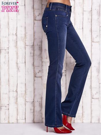 Niebieskie spodnie jeansowe boot cut                                  zdj.                                  2