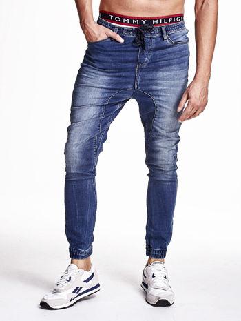 Niebieskie spodnie jeansowe męskie z troczkami