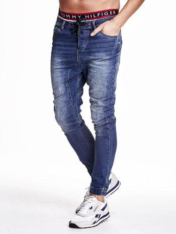 Niebieskie spodnie jeansowe męskie z troczkami                                  zdj.                                  3