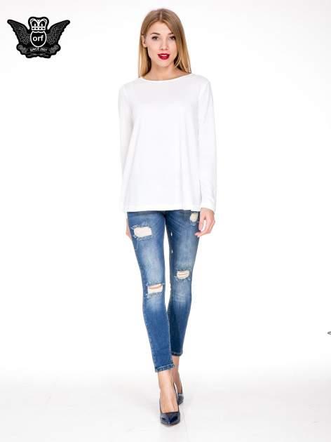 Niebieskie spodnie jeansowe rurki z dziurami i cieniowaniem                                  zdj.                                  2