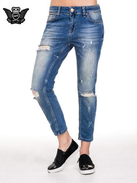 Niebieskie spodnie jeansowe rurki z dziurami i przetarciami                                  zdj.                                  1