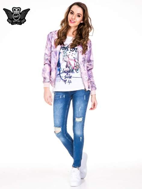 Niebieskie spodnie jeansowe rurki z dziurami i wytarciami                                  zdj.                                  2