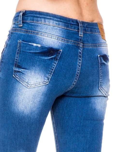 Niebieskie spodnie jeansowe skinny do połowy łydki                                  zdj.                                  7