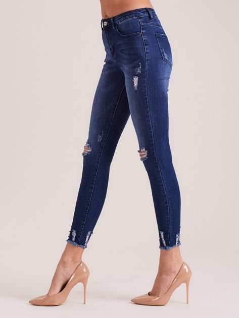 Niebieskie spodnie jeansowe skinny z dziurami                              zdj.                              3