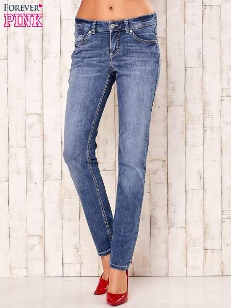 Niebieskie spodnie jeansowe z prostymi nogawkami                                  zdj.                                  1