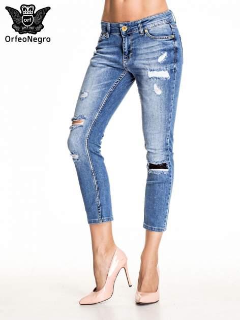 Niebieskie spodnie skinny jeans z łatami                                  zdj.                                  1