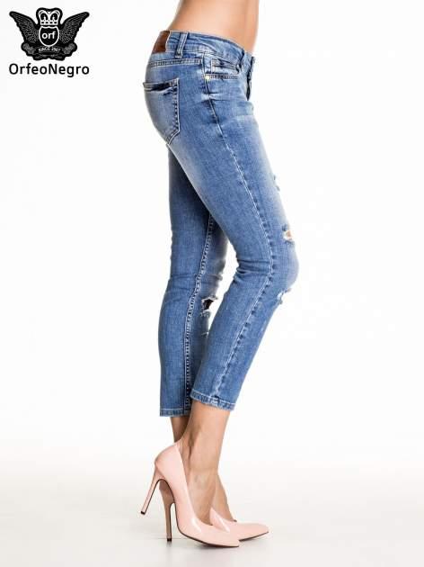 Niebieskie spodnie skinny jeans z łatami                                  zdj.                                  3