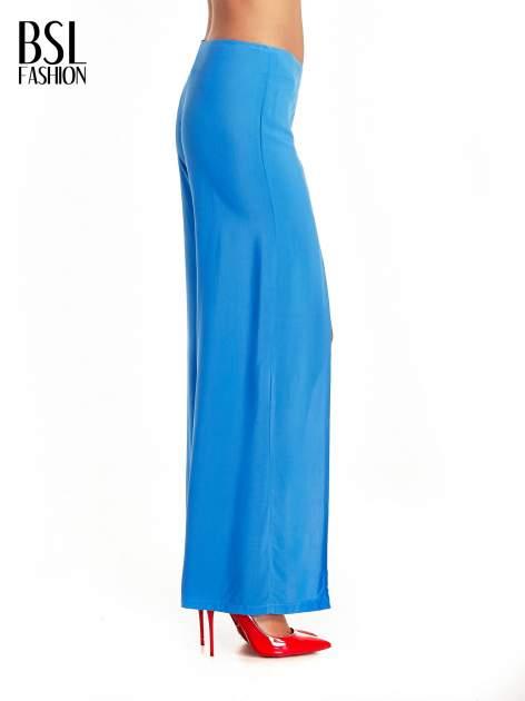 Niebieskie szerokie dzwony culottes z rozcięciami                                  zdj.                                  3