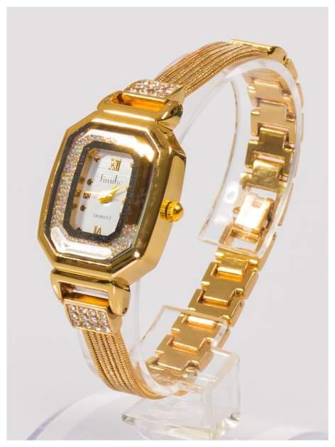 Ozdobny złoty damski zegarek z cyrkoniami na stalowej bransolecie z łańcuszkami                                  zdj.                                  1