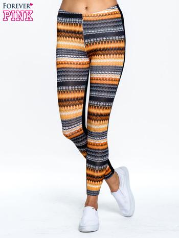 Pomarańczowe legginsy two tone w etniczny wzór