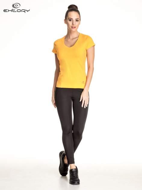 Pomarańczowy damski t-shirt sportowy z dekoltem V PLUS SIZE                                  zdj.                                  2