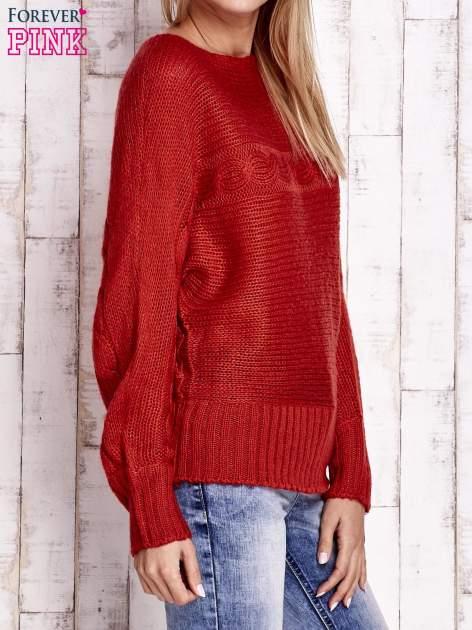 Pomarańczowy sweter z warkoczowym splotem                                  zdj.                                  3