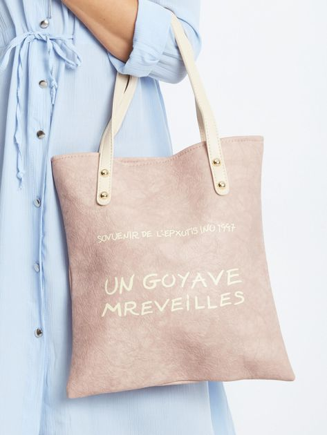 Pudroworóżowa torba z napisem