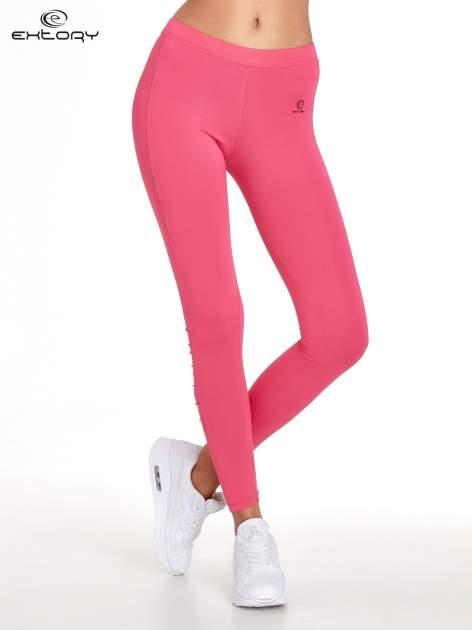 Różowe legginsy sportowe termalne z drapowaniem