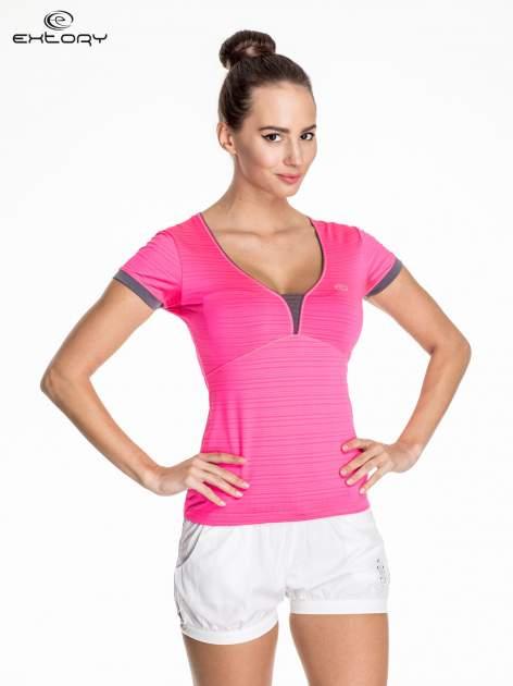 Różowy damski t-shirt sportowy w paski z lamówką