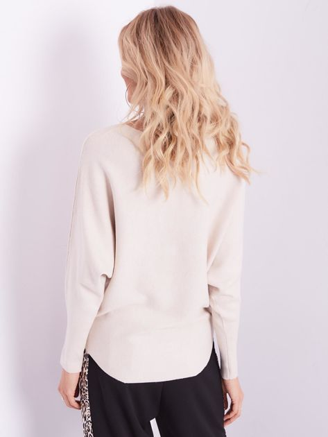 SCANDEZZA Beżowy sweter oversize z błyszczącym napisem                              zdj.                              11