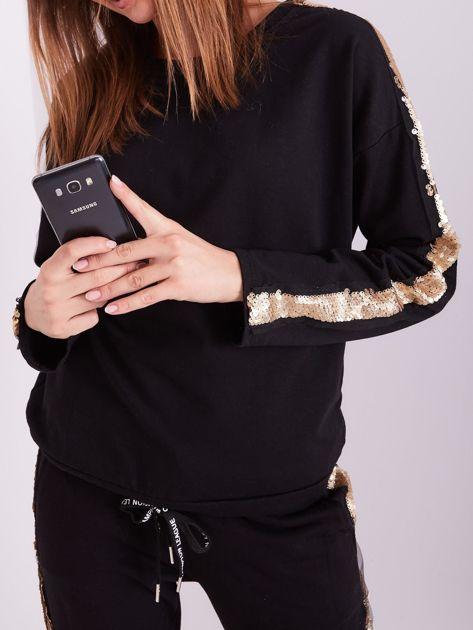 SCANDEZZA Czarna bluza ze złotymi cekinami                              zdj.                              1