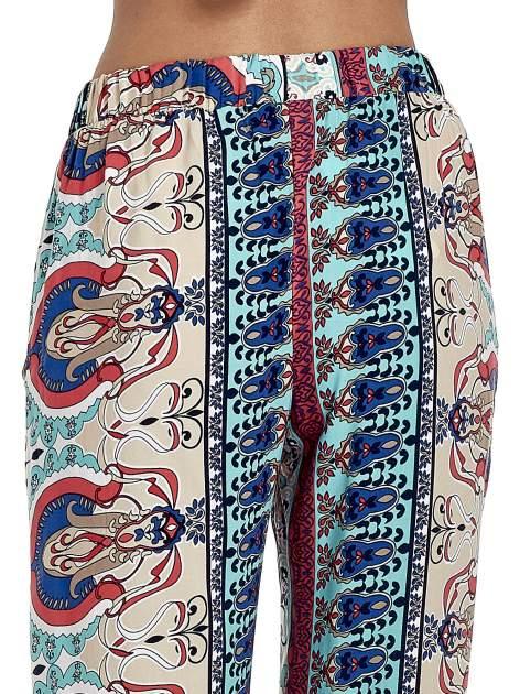 Spodnie dzwony we wzór ornamentowy                                  zdj.                                  7