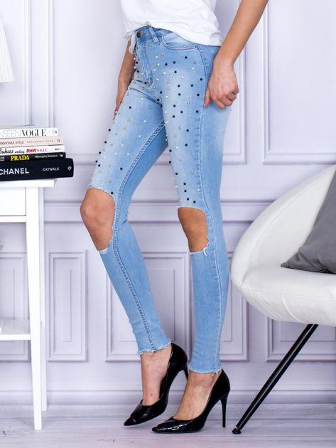 Spodnie jeansowe z dziurami i perełkami niebieskie                              zdj.                              3